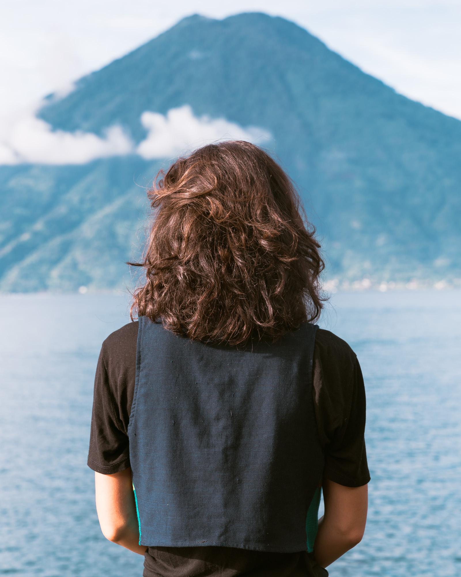 Woman looking at Volcano Toliman at Lake Atitlan