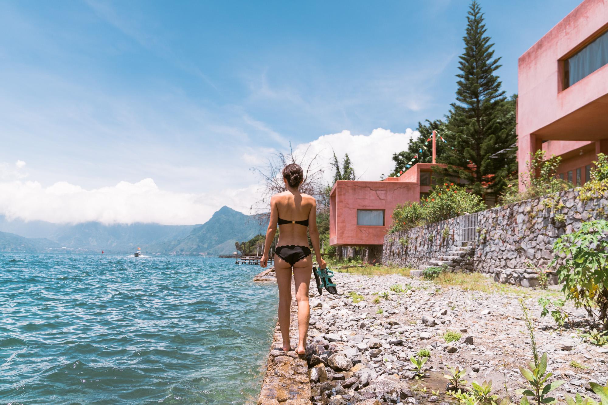 Woman walking next to the water at lake Atitlan, Casa Rosada