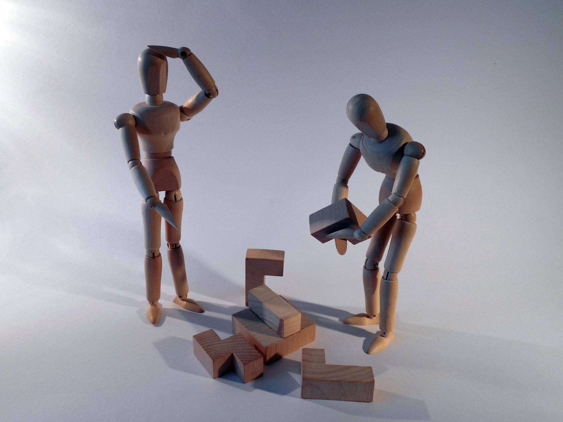 Wooden models building a puzzle
