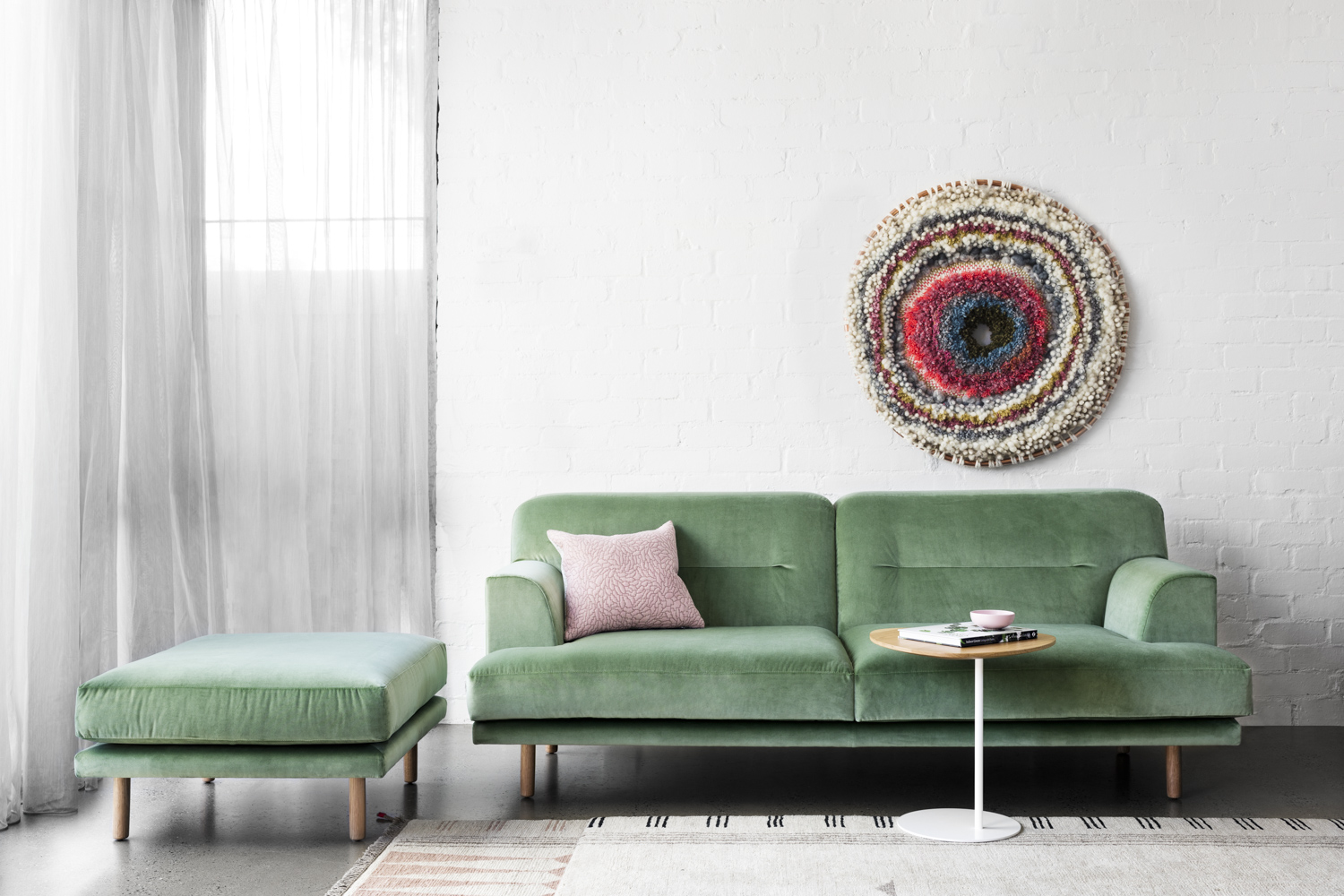 Camille sofa, 2.5 seater and ottoman in Velvet with Zoe table. Woven wall piece by  Tammy Kanat .