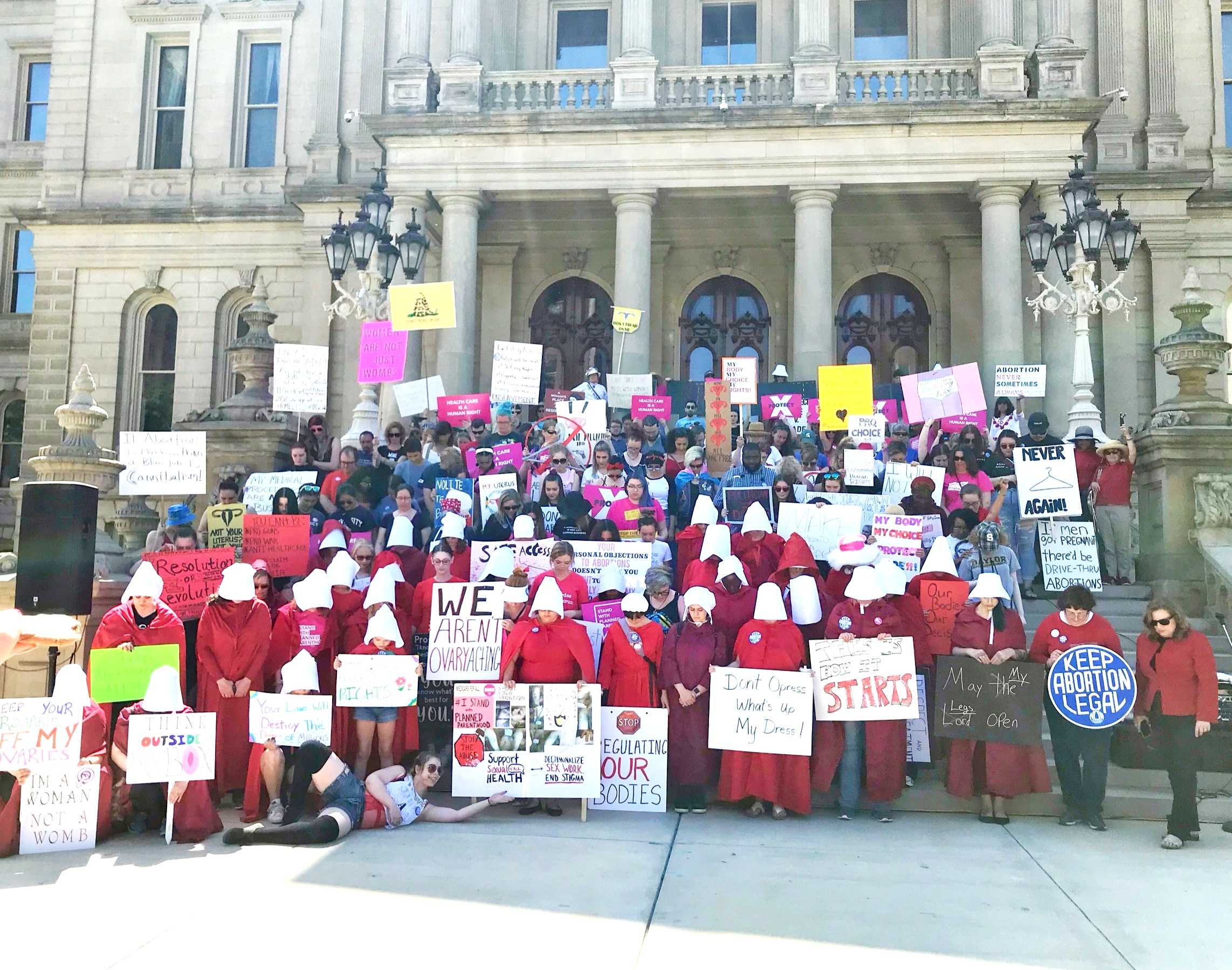 Handmaid's Tale Rally Against the Abortion Ban. Lansing MI June 2019. Women's reporoductive rights were the focus and so many supporters were in true Handmaids garb to hear the impressive lineup of speakers. Fems for Change volunteers partnered with LWV members from Lansing to offer voter registration.