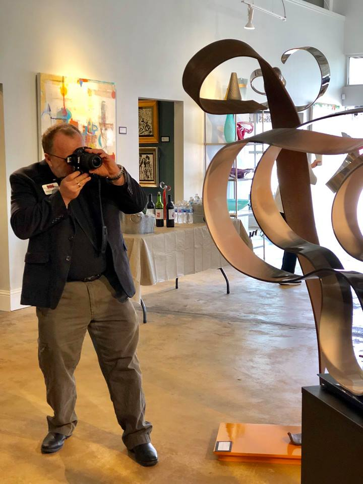 I enjoy shooting photos of everything. Here I am photographing some wonderful art pieces (not mine) at the Frisco Fine Art gallery.