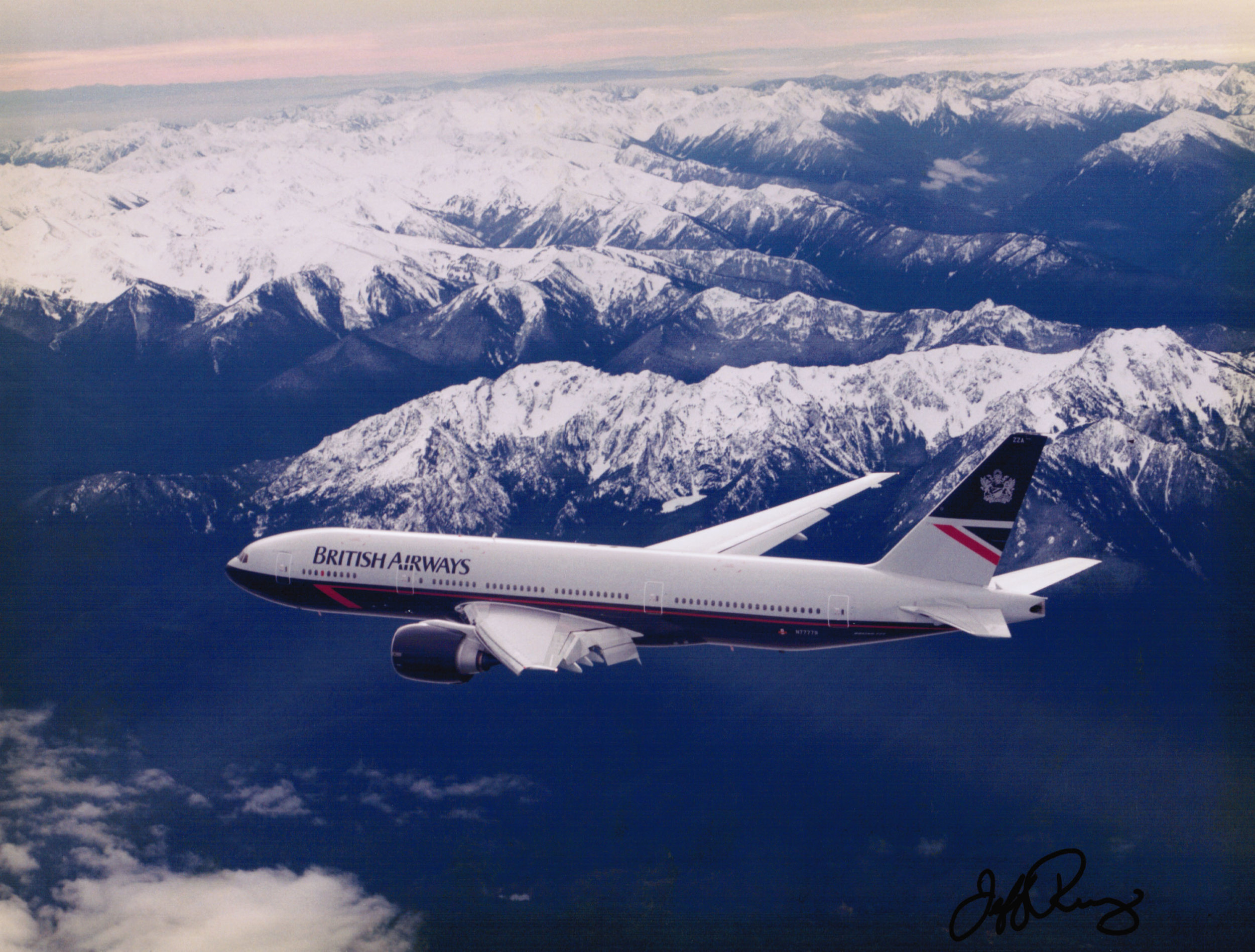 777 Photo courtesy of my friend, Jeff Rumsey, Boeing flight test photographer. He shot from the chase plane high over the Olympic mountains in western Washington state. I love the old British Airways paint scheme.