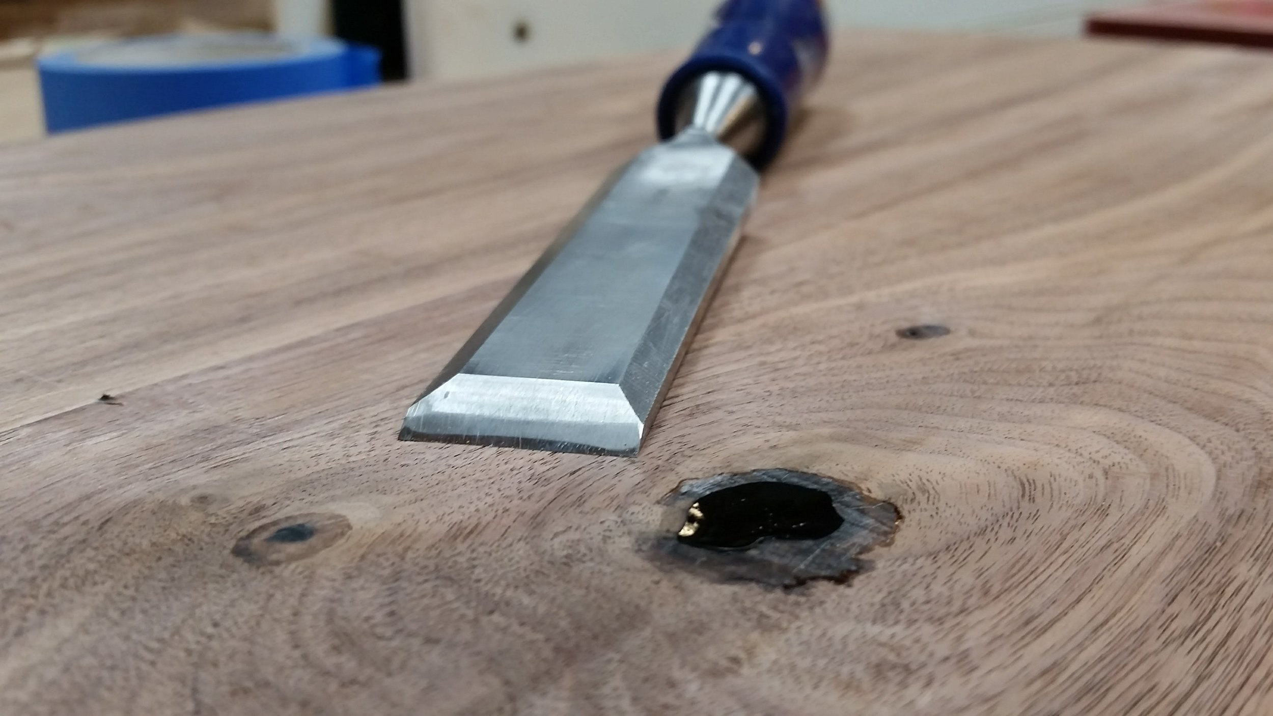 A little chisel work to clean up the epoxy overflow around the knot hole on the bottom of the seat slab.