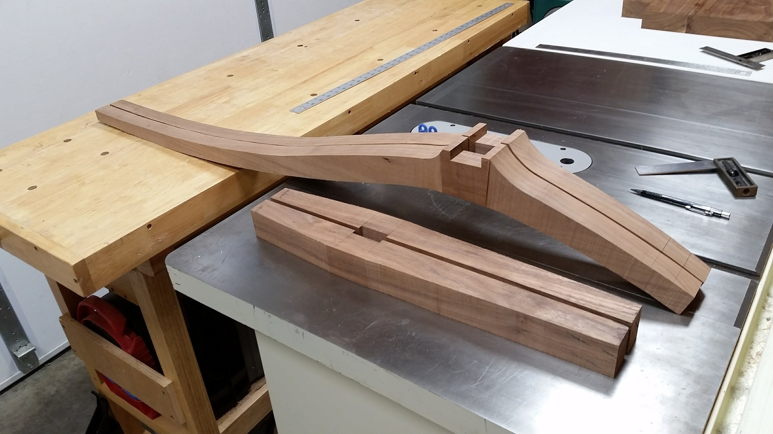 After some simple layout lines, I cut tapers into the edges of the front and rear legs using the bandsaw.