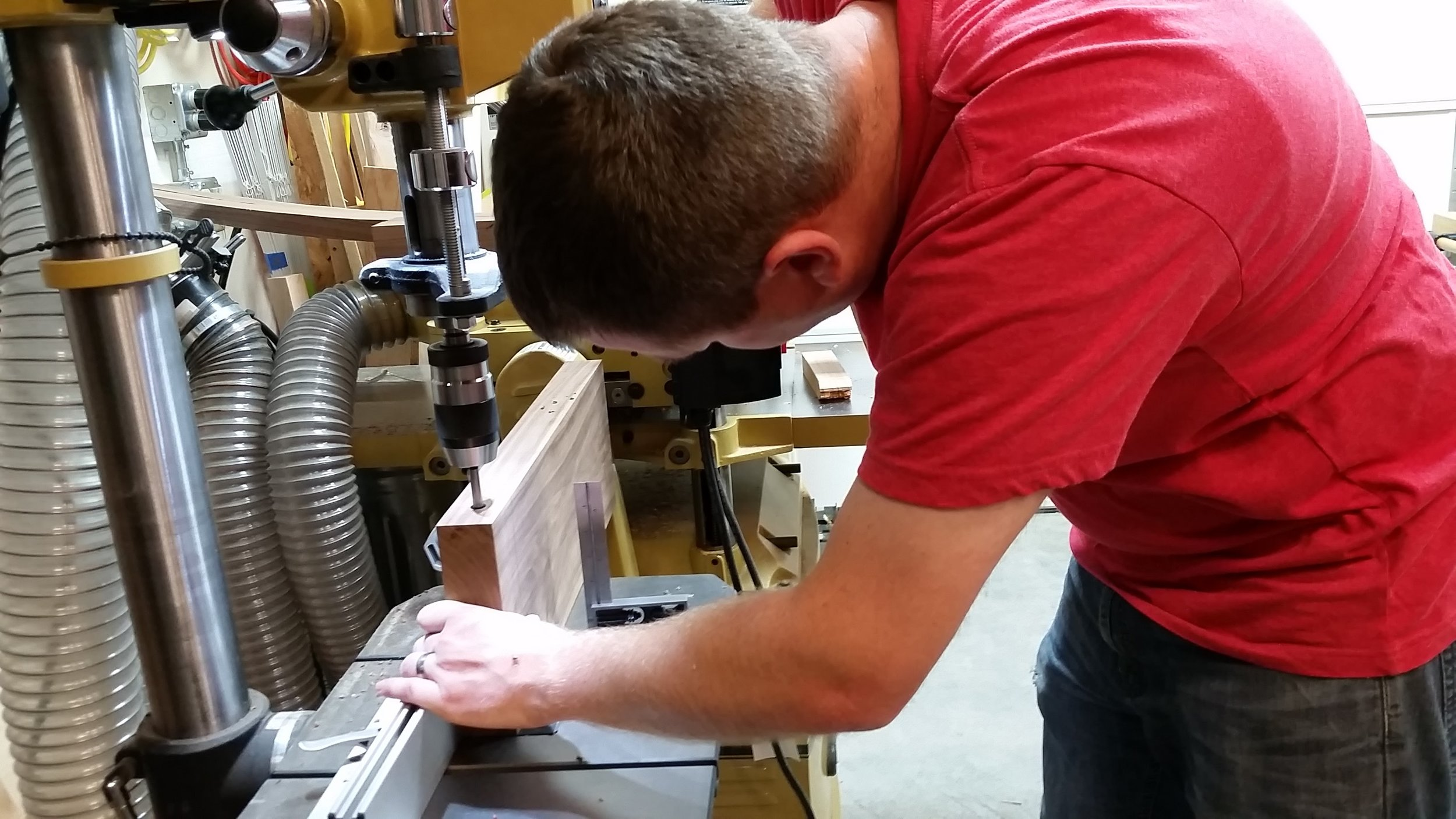 Drilling dowel holes in the edge of one of the seat boards.