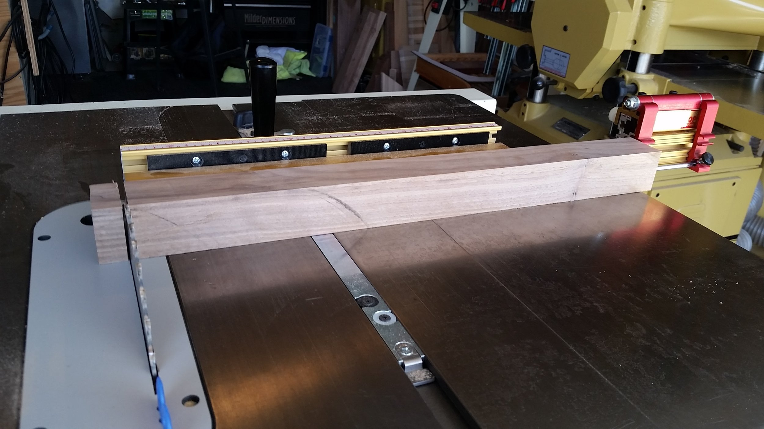 Cross cutting the front legs to length with the miter gauge.