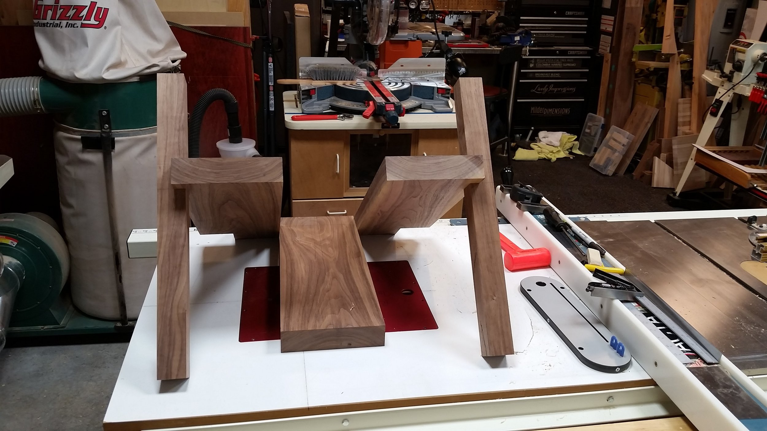 Here's the front legs fitted onto the outside seat boards.  It's starting to actually resemble a piece of furniture!