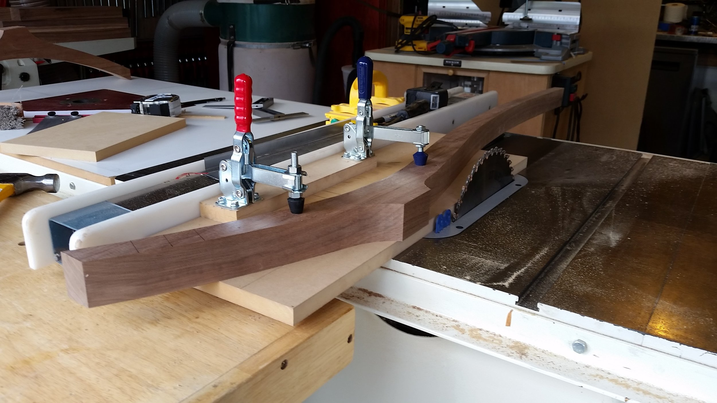 Rear leg clamped in jig and run through the table saw to cut the angle where the seat will join to the rear leg.