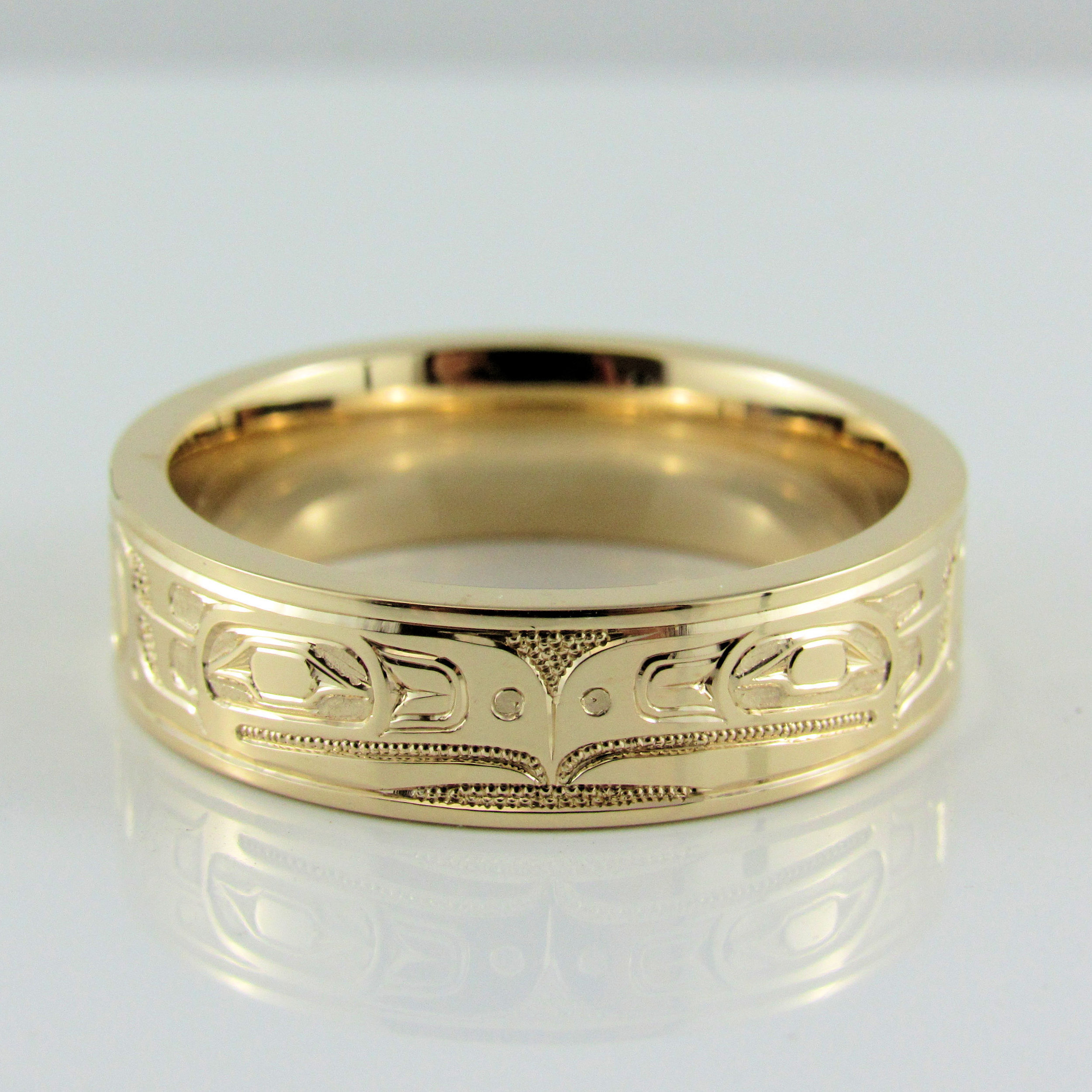 Eagles Band - This incredible band is hand engraved with Haida eagles. Simple and timeless. A ring all men love.#Haida #Eagle