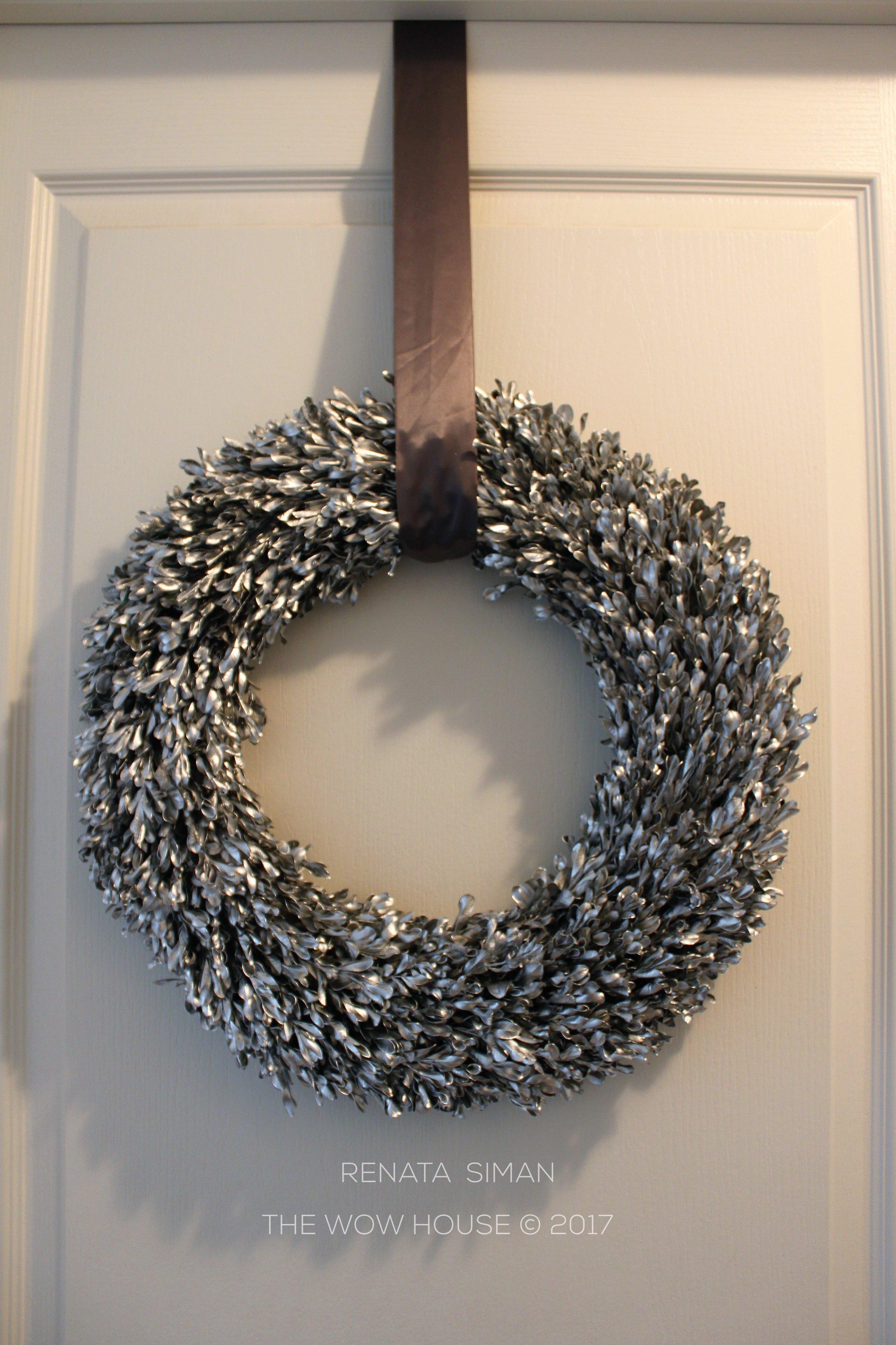 Hung on charcoal-gray satin sash