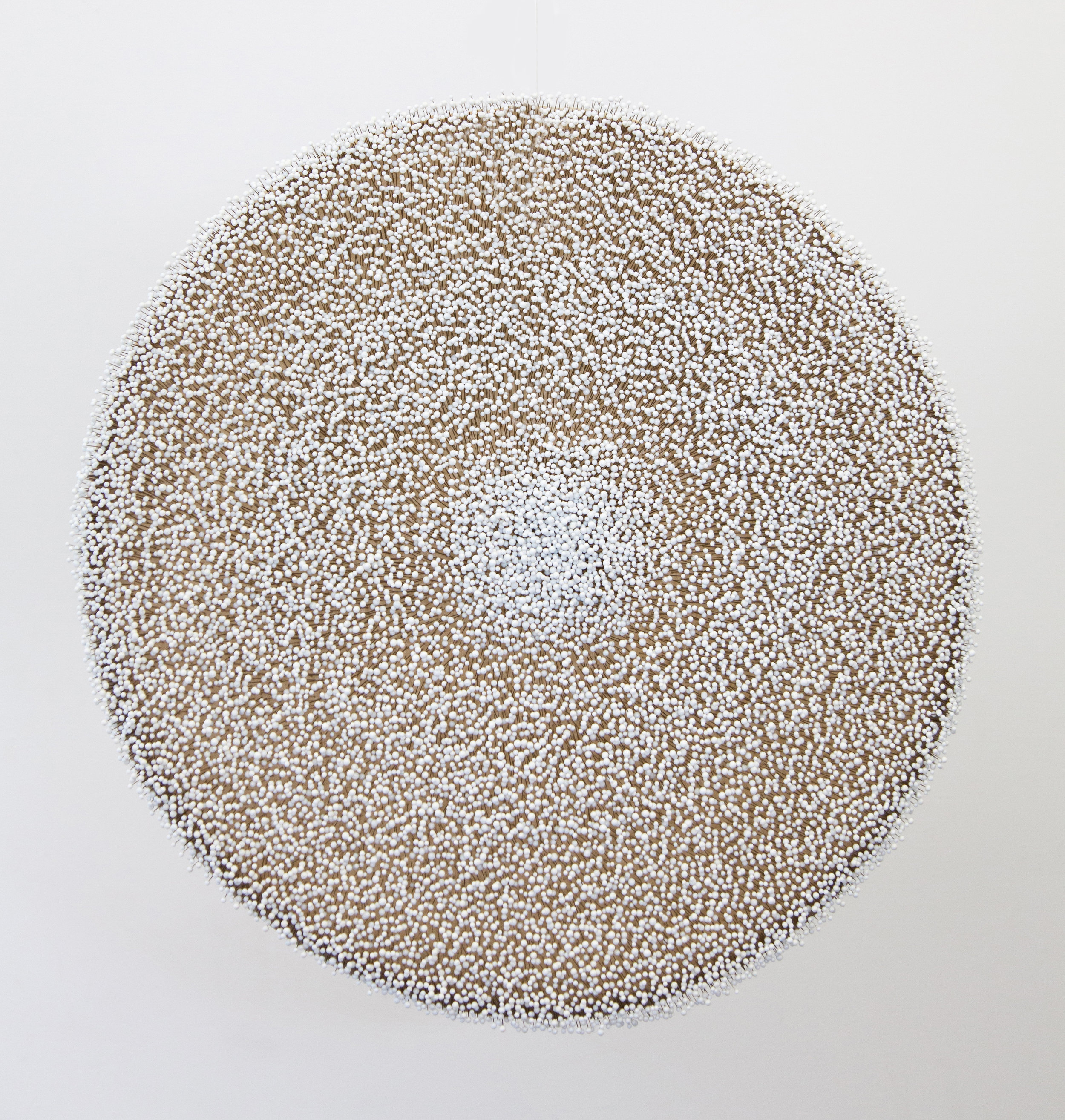 "Elements, front, white glass head pins, steel frame, linen and wax, 2.5' diameter x 4"" deep, 2006/2012"
