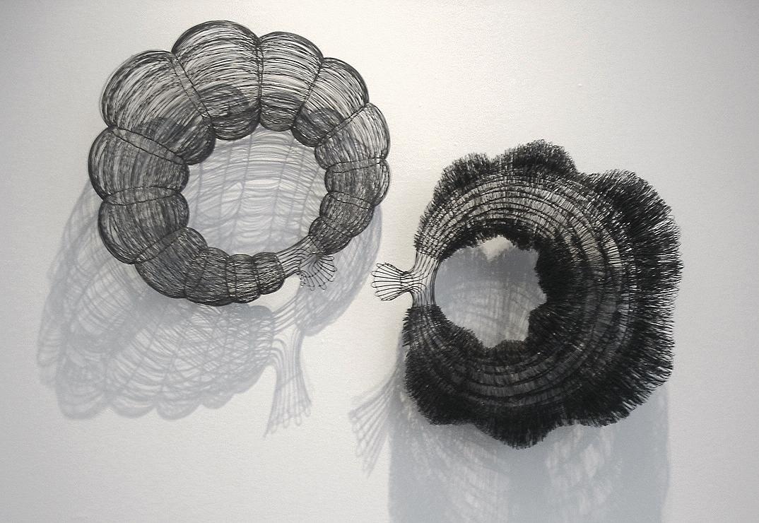 Valence, steel wire, 2.5' diameter each sculpture