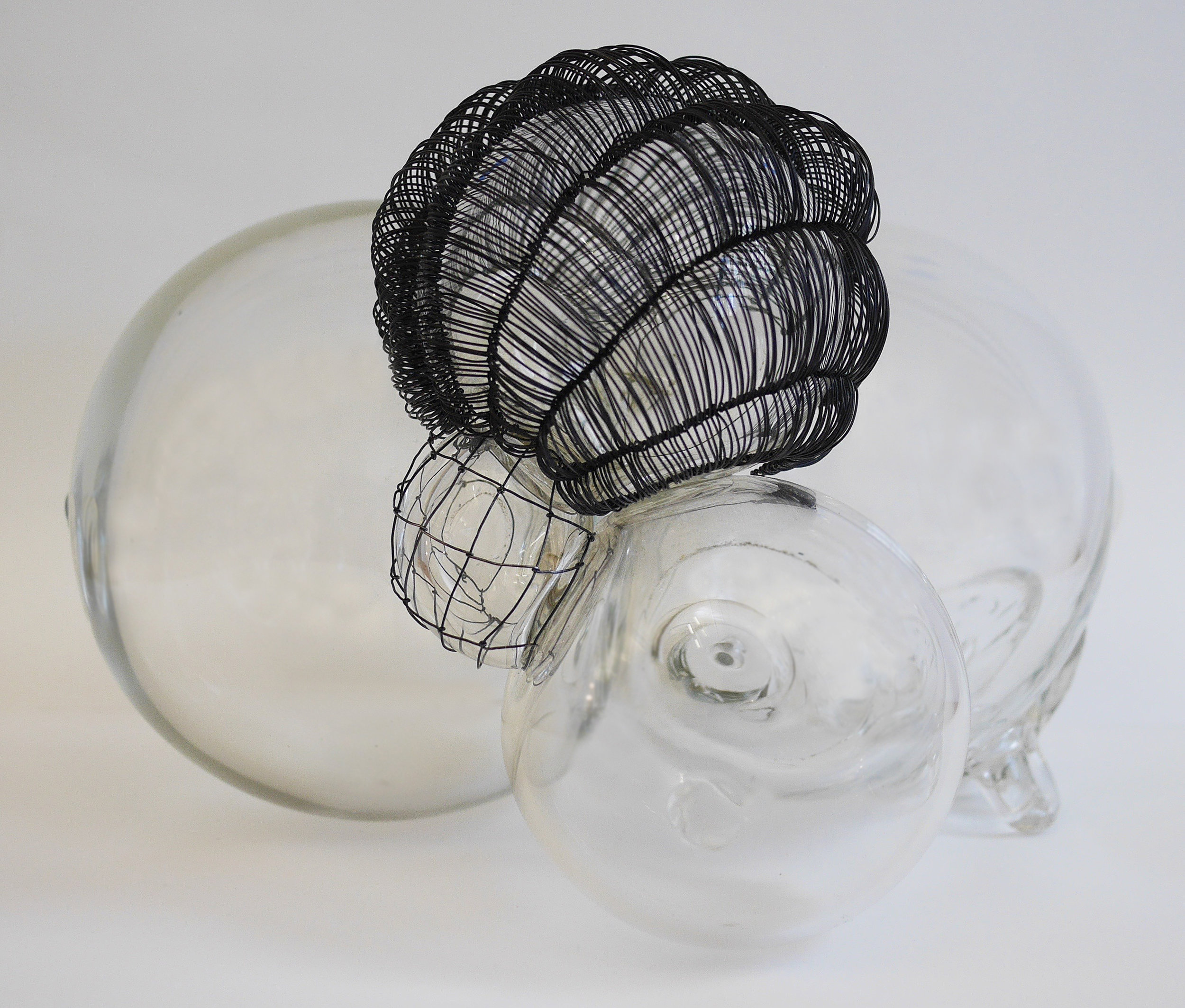 "Caged 3, blown glass with woven steel wire, 10""x10""x9"" , 2018"