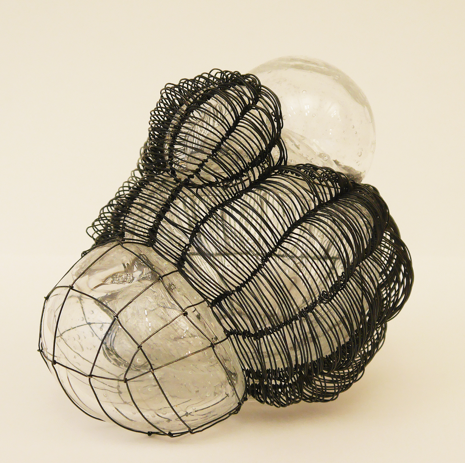 "Caged 5, blown glass with woven steel wire, 5.5""x7""x5"", 2016"