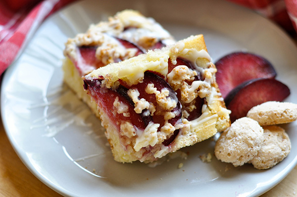 Amaretti Plum Crunch Cake_sliced drizzled HERO-0073.jpg