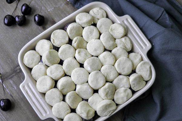 Summer Cherry Cobbler_biscuit dough placed.jpg