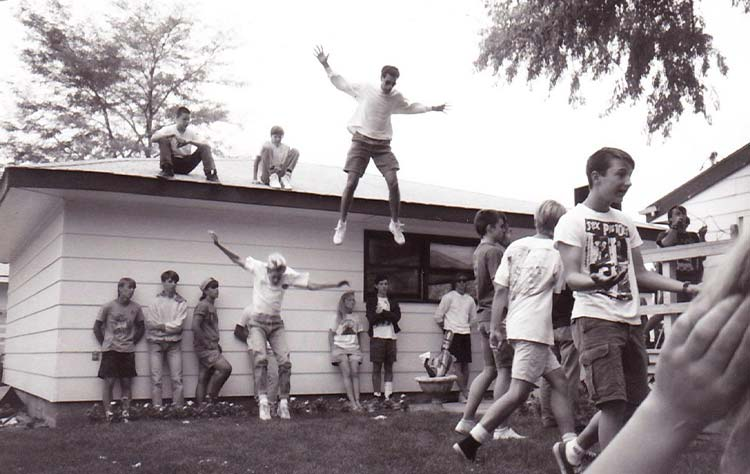 Shane De Leon jumping at a Billings punk party
