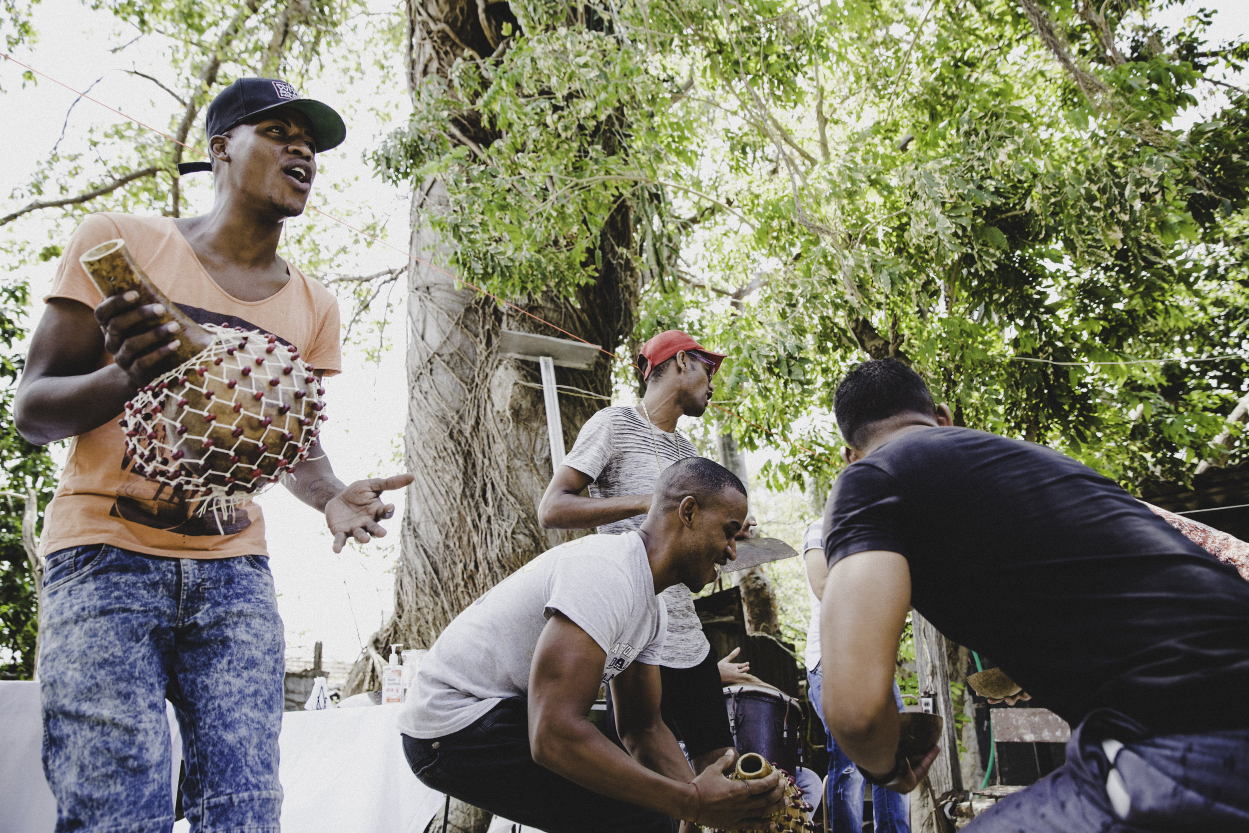 Young men playing spiritual AfroCuban music. Photo by Emory Hall for Comuna Travel.
