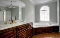 Master bathroom is spacious but was in need of some style and good lighting