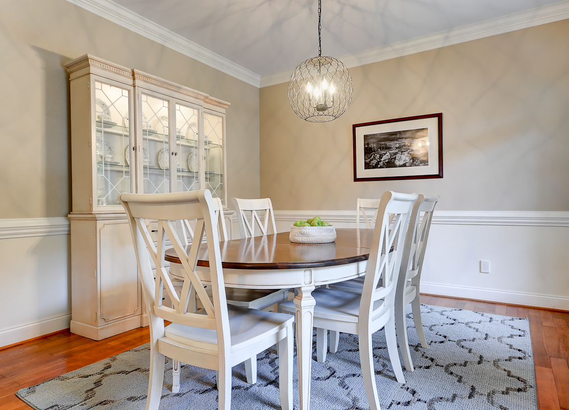 A new rug, lighting and paint changed this office into a gorgeous dining area