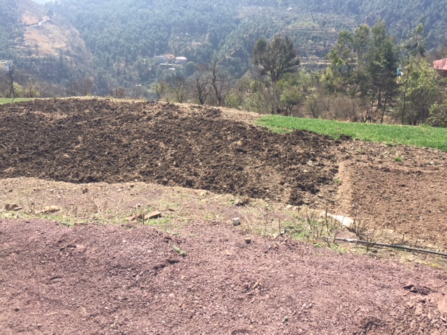 Making pastureland on the side of a mountain.