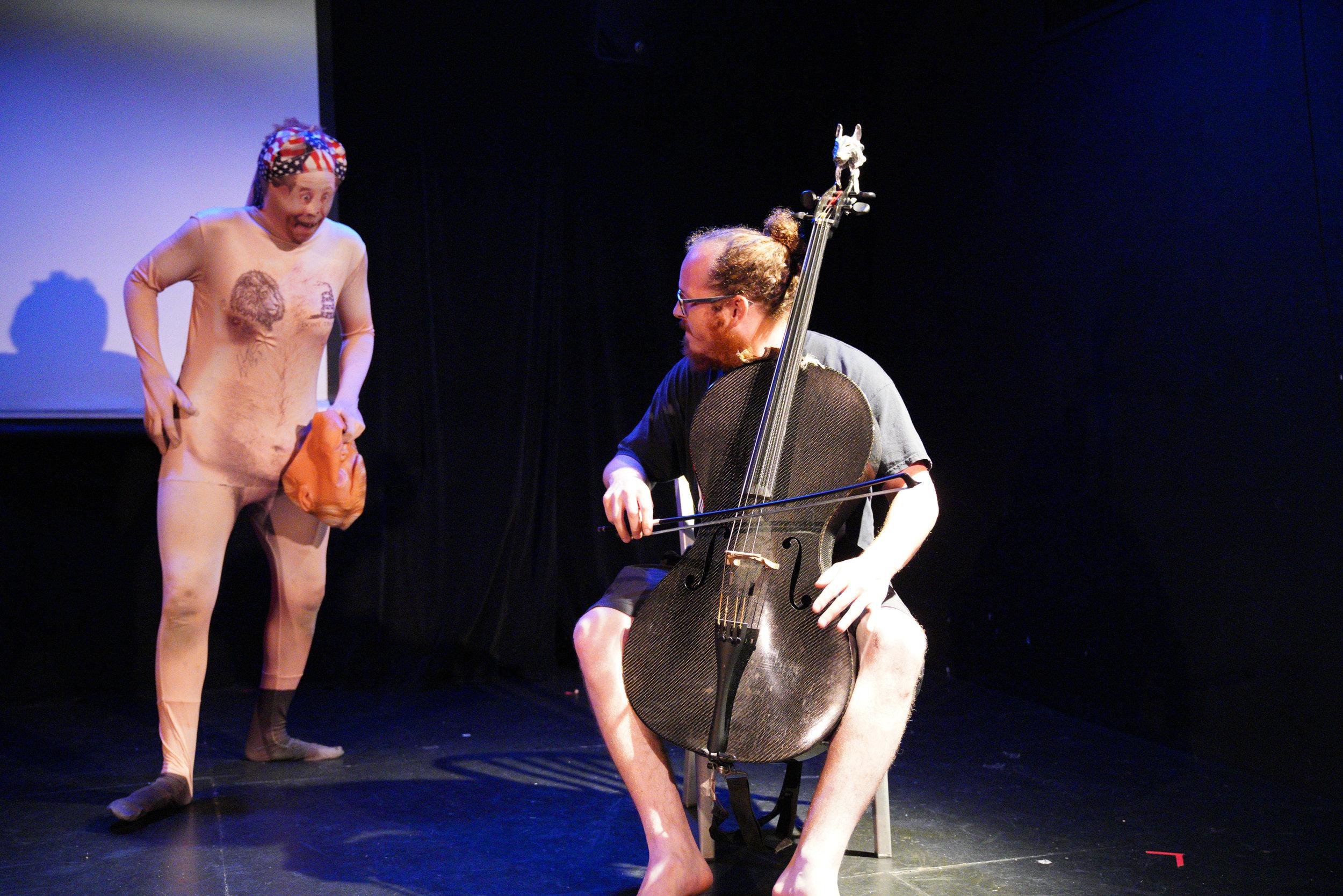 Cellist Jacob Cohen and performance artist Uniska Wahala Kano. Photo by Steven Pisano