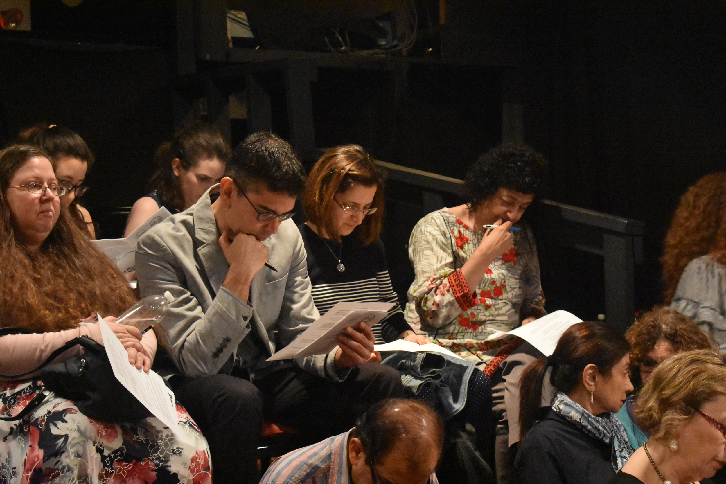 Audience members worked on their medieval poetry during the workshop.  Photo by Mollie Block