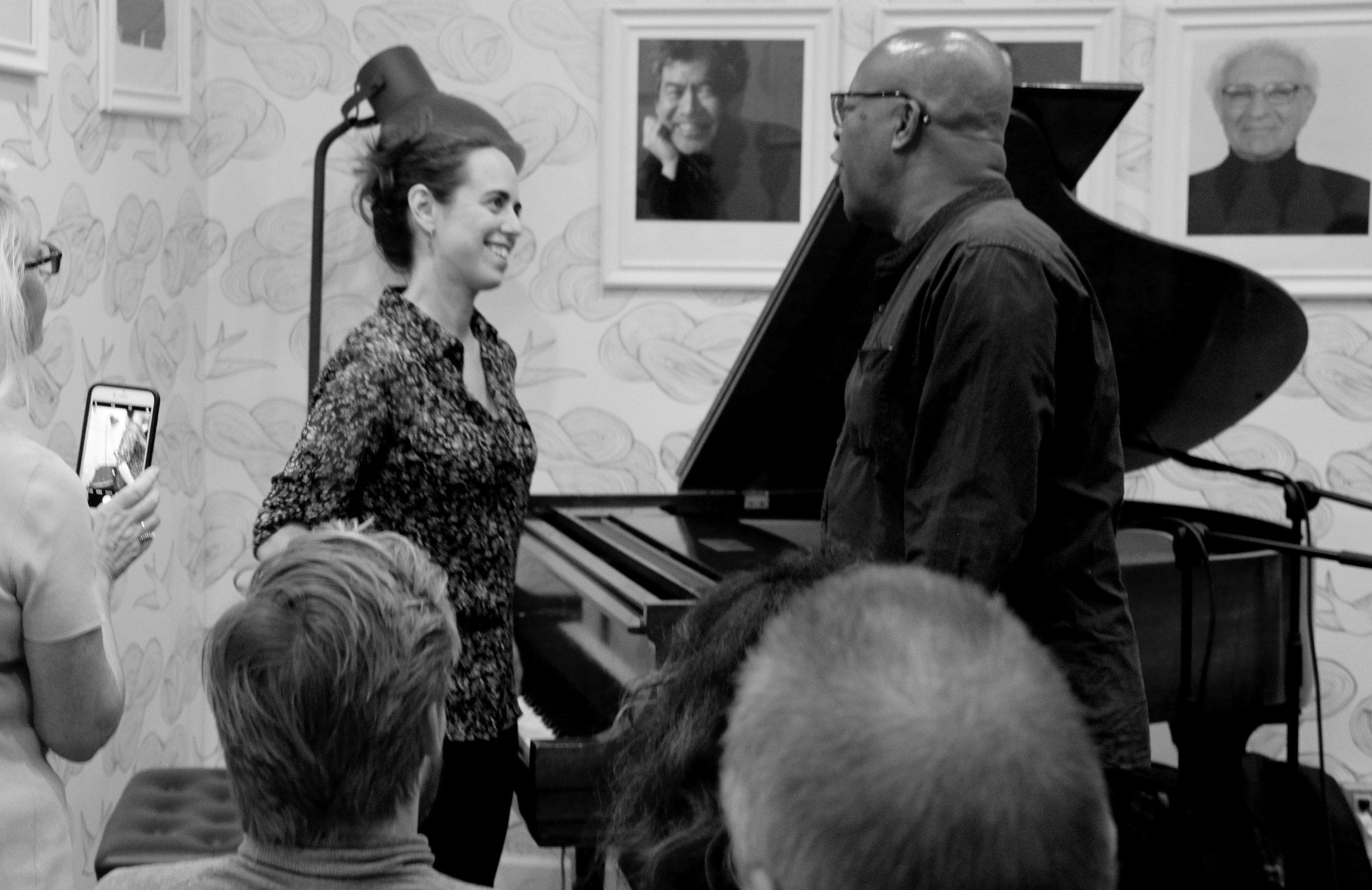 Mara Rosenbloom talks with jazz musician William Hooker.  Photo by Jagruti Deshmukh.