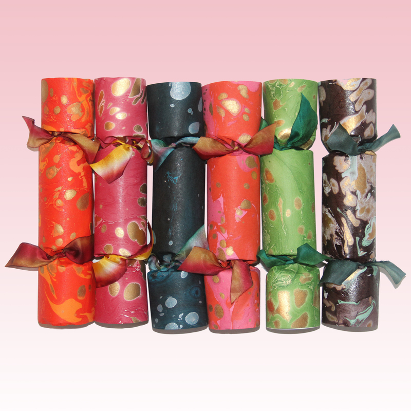 Marbled Party Crackers. Multicolored artisan paper and dip-dyed silk ribbons. An exclusive item from the  Sugarplum pop-up , online and also at the St. Regis New York.
