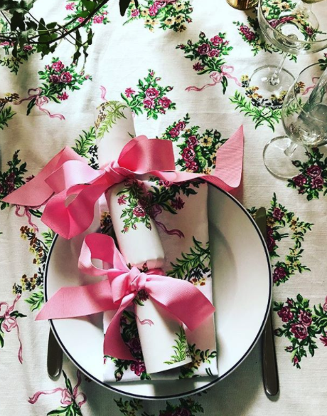 """Still crazy for crackers...  Fiona Leahy Designs  sets a """"Chintzmas"""" tablescape with bespoke crackers tied with a simple grosgrain ribbon. So chic."""