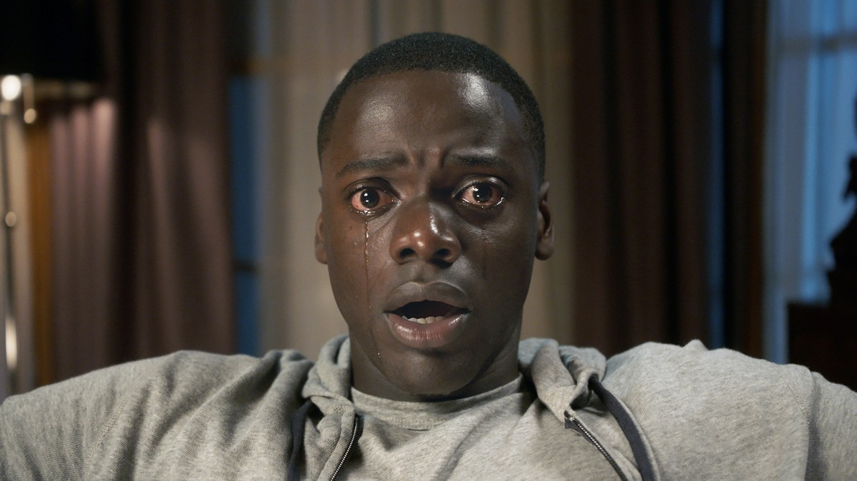 "#1 Get Out - The genre of ""horror"" was redefined this year with Jordan Peele's rom-com-gone-psycho-thriller Get Out. Horribly relevant and finely-tuned with moments of absurd disbelief, Get Out speaks not only as an artistic masterpiece, but as part of a movement (see: Black Lives Matter) as well. The horror of Get Out rested not only in the confused visit young, Black and handsome Chris takes to visit his white girlfriend Rose's family in Upstate New York, but in the reality that takes hold, the reality that Black Americans face everyday. In the chilling glances from the family's servants and the dissonance between Chris believing his instincts and being blinded by the family's ""charming"" ways, there is a beautiful interplay between suspense and confusion. Peele's ability to portray real life as horror, in an impossibly unbelievable and yet not unfamiliar way, marks Get Out as a work of cinematic and activist genius, earning it a place at the top of its genre, not only now, but for many more years."