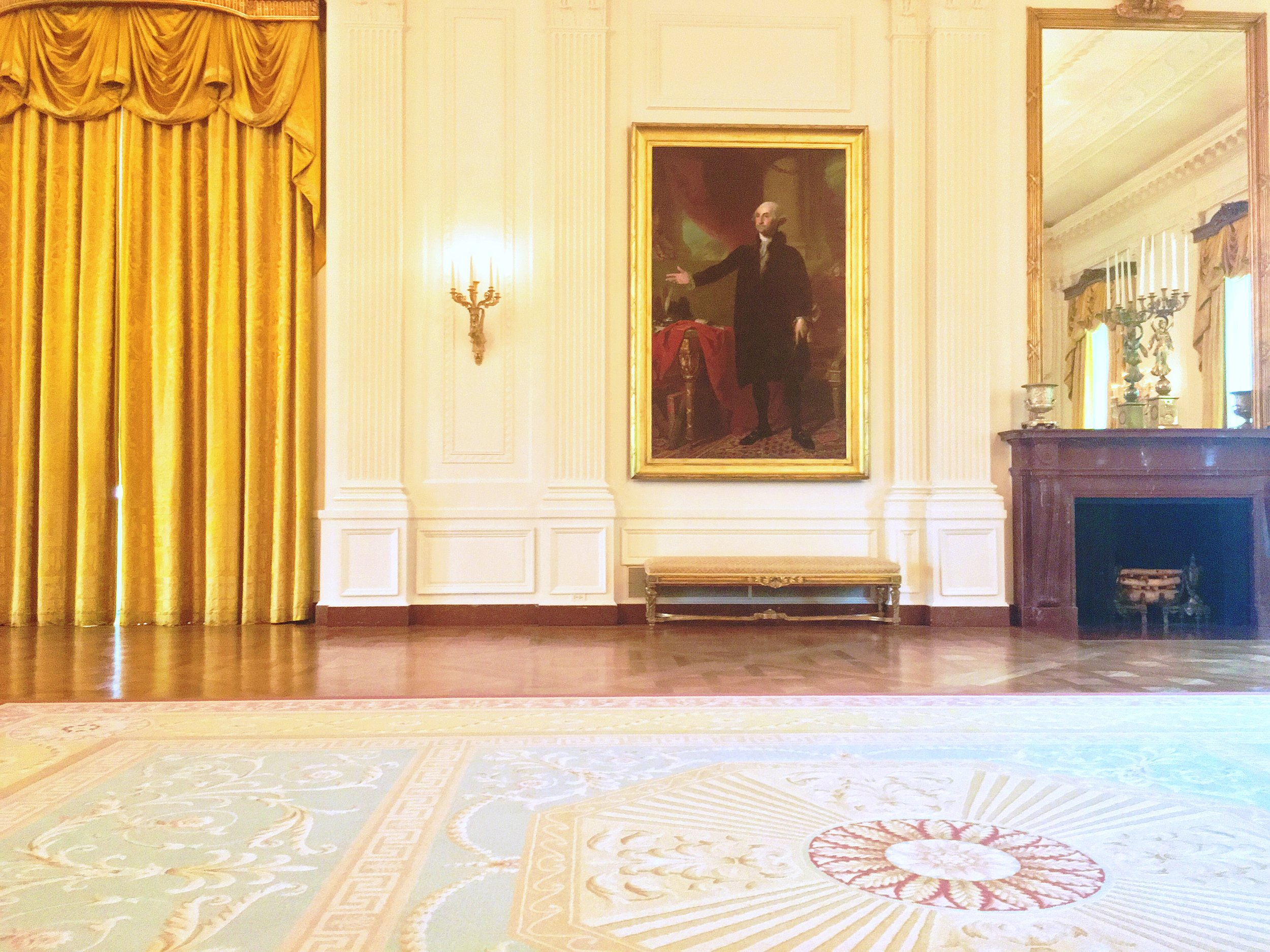The East Room features a portrait of George Washington that First Lady Dolley Madison saved when the British burned the White House in 1814.