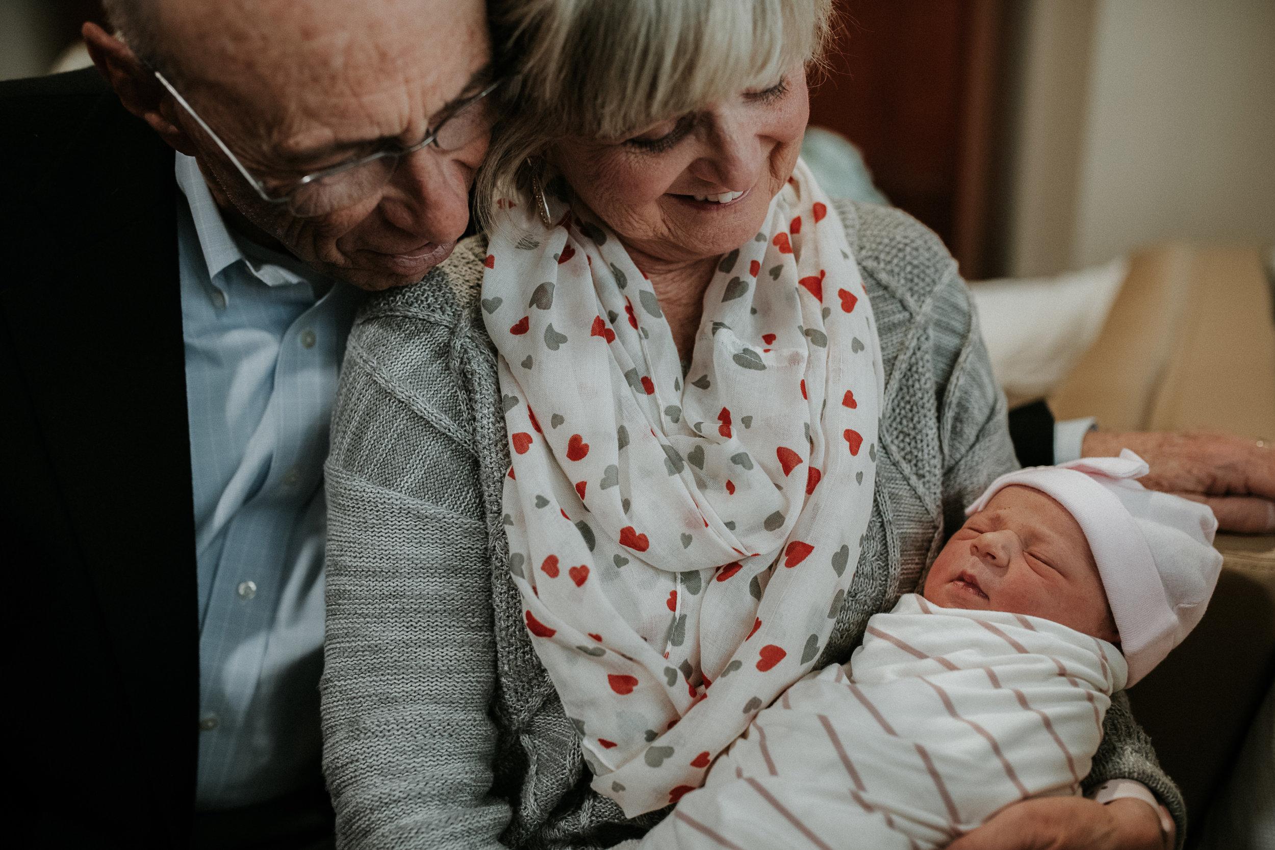 """BobBob"" and ""Nanny"" (Steven's parents) cuddle Kezia"