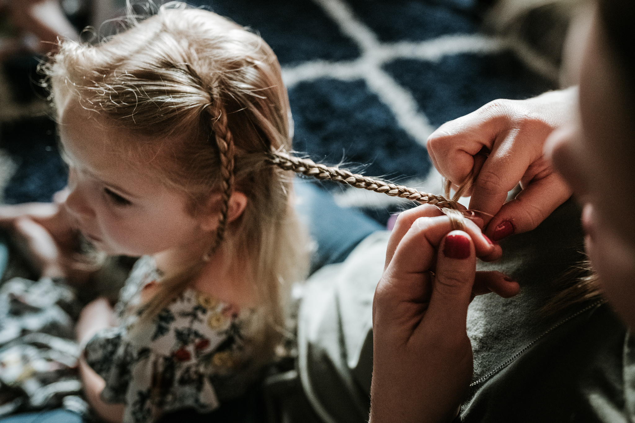 Sara braids Kinsely's hair.  There is a stillness and patience involved here in both parent and child that I find really beautiful.