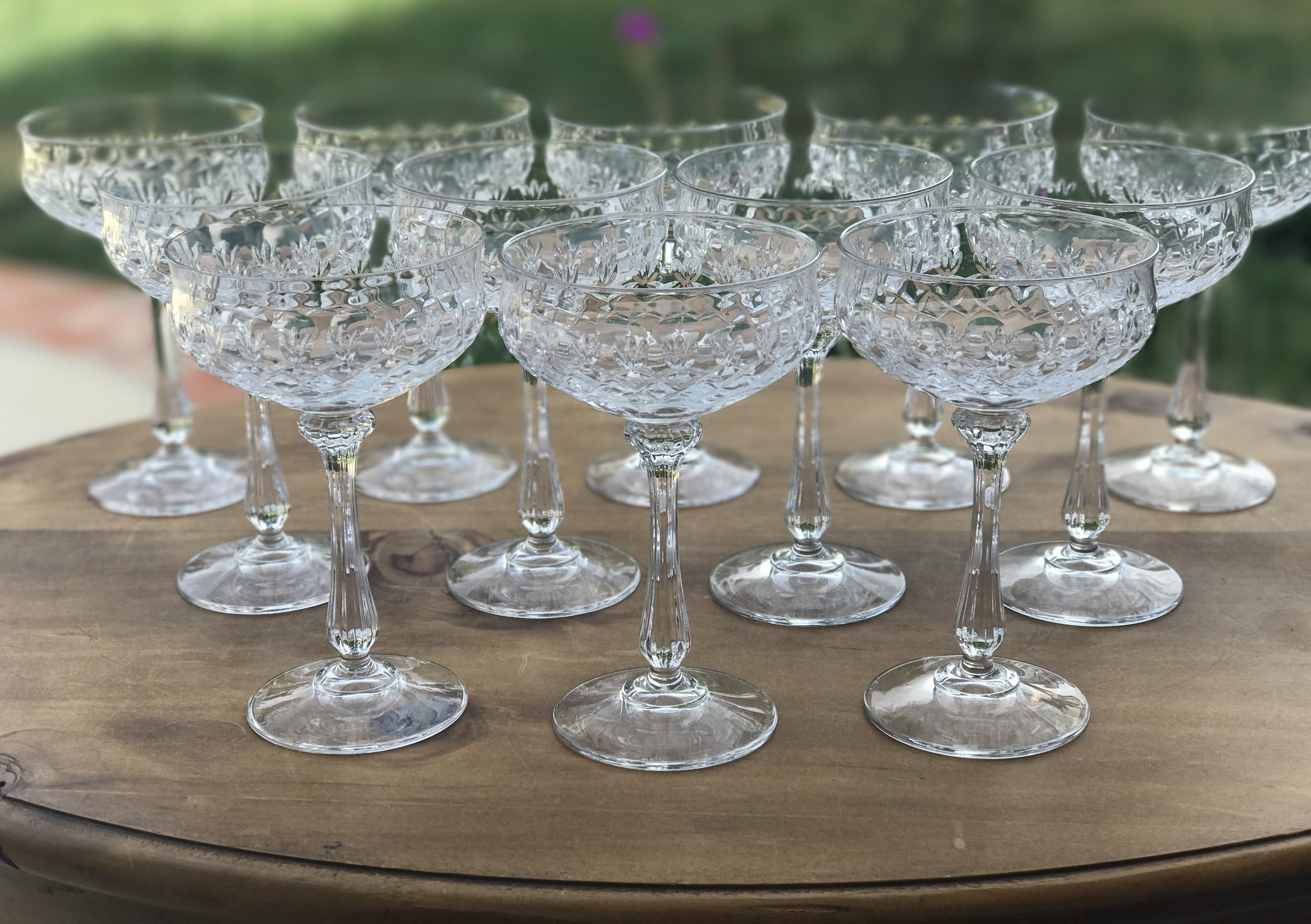 mismatched and matching crystal wine, water, champaign, goblets situated on a table in the Temecula Valley.