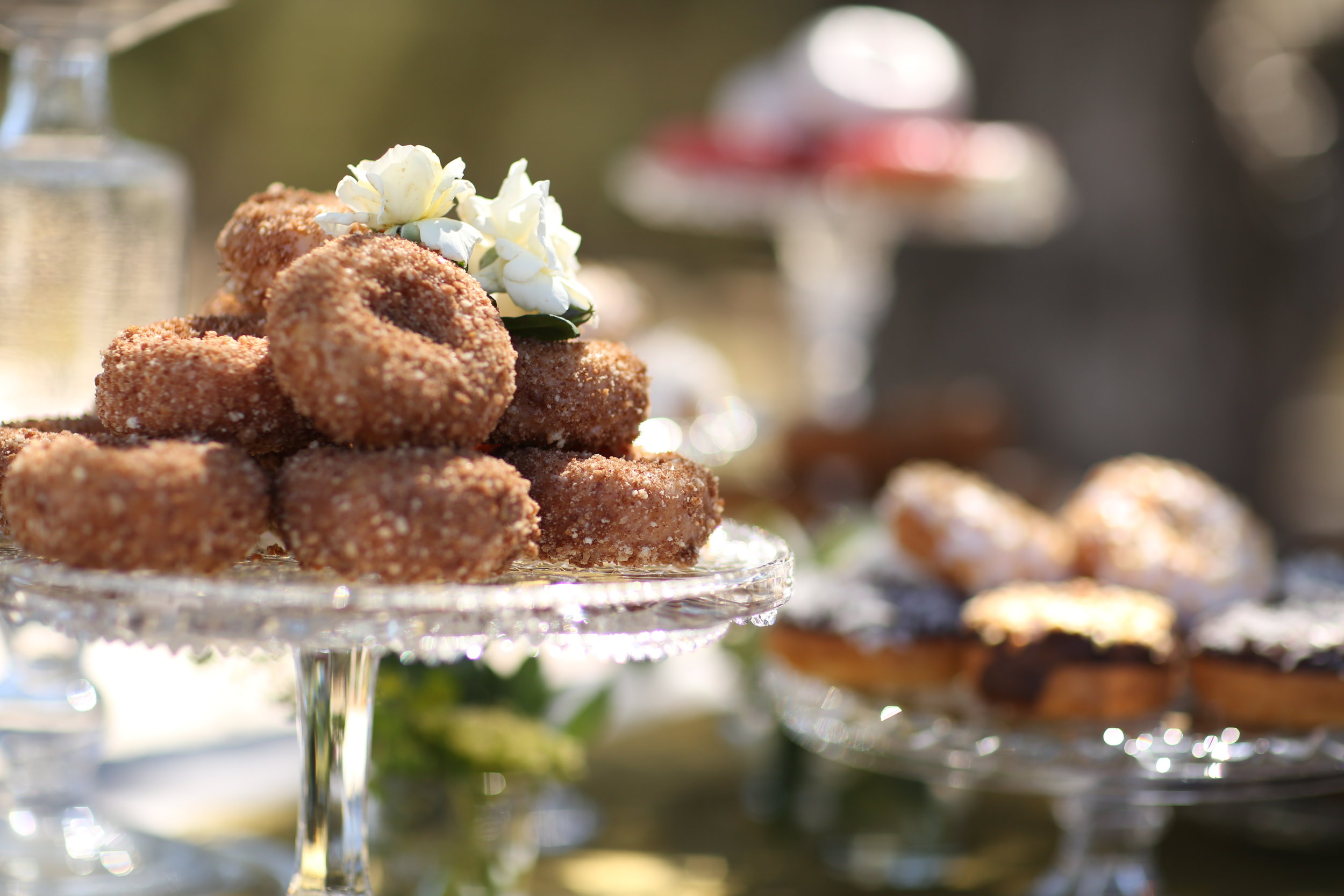 Pedestal platters, crystal platters, pitchers, bowls, Plates with donuts from a donut shop in the Temecula Valley