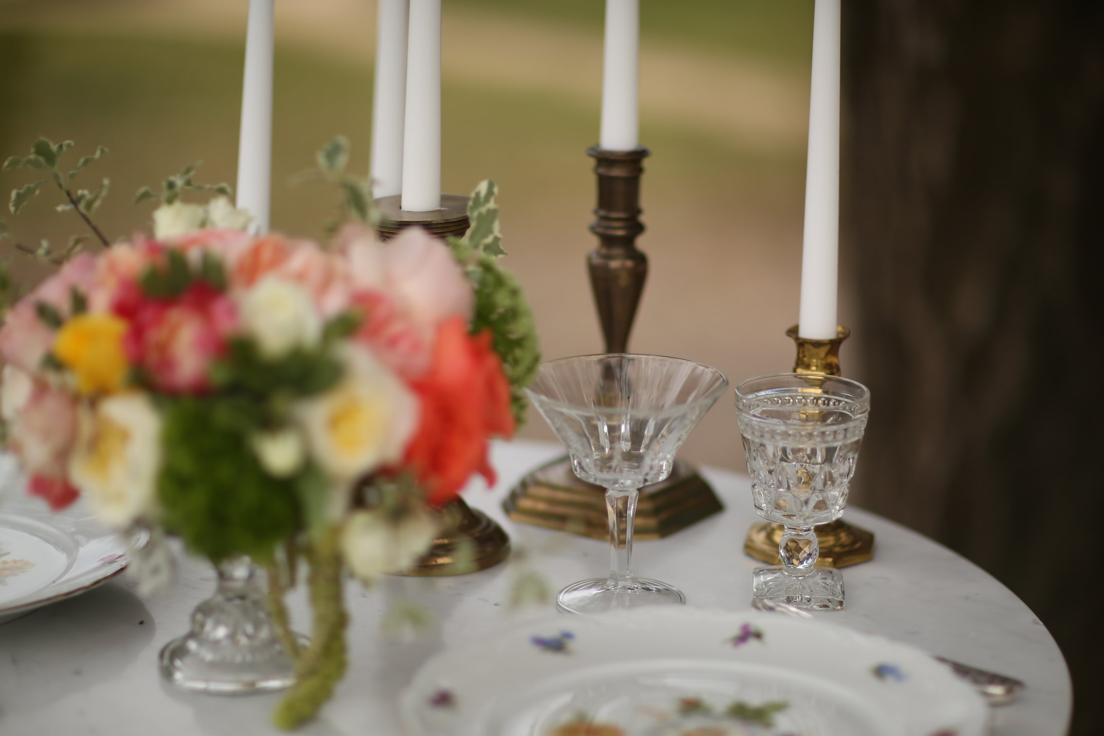 EAPC cut glasses with vintage floral china and brass candlesticks. Spring flowers in a crystal compote.