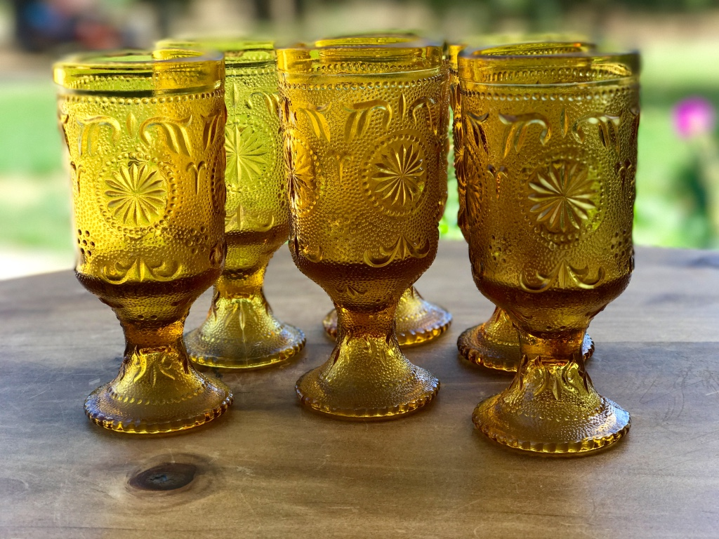 mismatched vintage mid century modern amber goblets and glasses. Rentals Murrieta.
