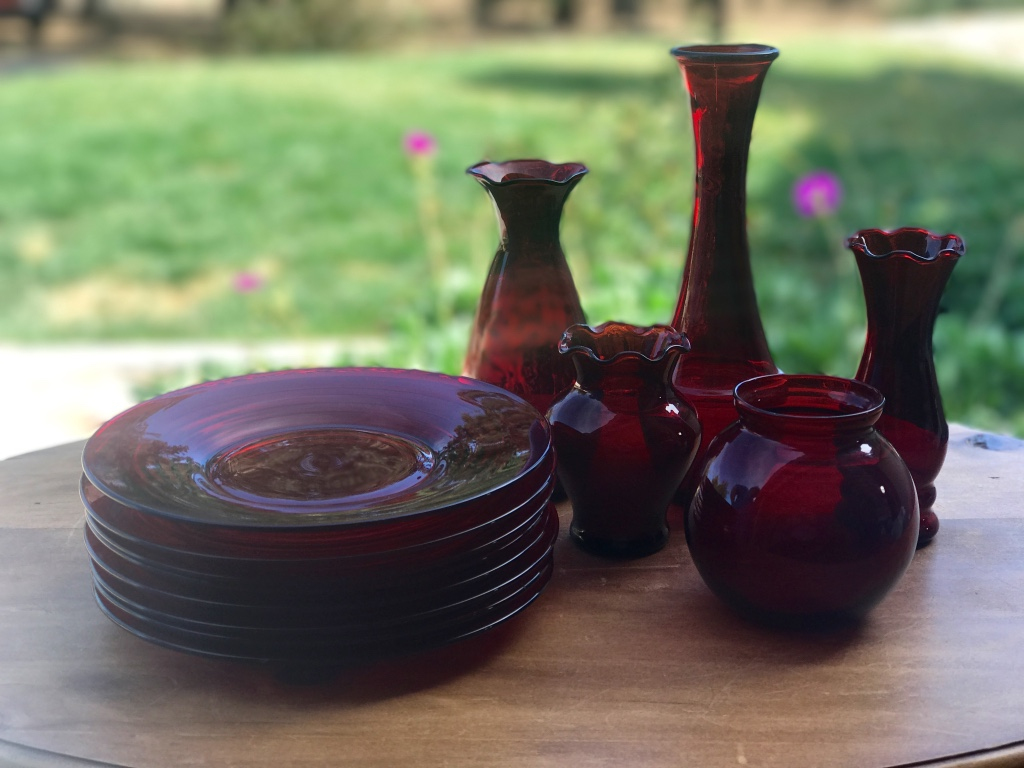 Mid century modern ruby glass pieces. Dessert plates, and vases. Wedding rentals in the Temecula Valley.