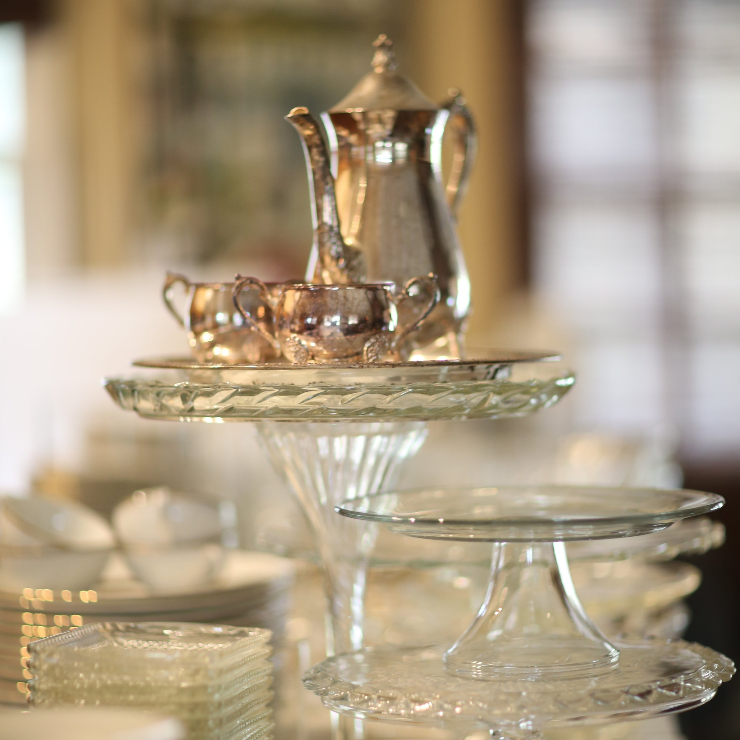 Vintage Silver Tea pot on top of cut glass crystal pedestal platters.. Stored in our warehouse in Murrieta near Temecula, California in the Temecula Valley