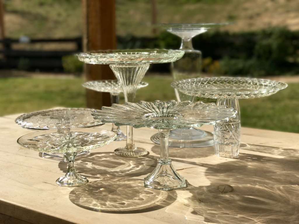 Assorted mismatched vintage cut glass and crystal pedestal platters and cake plates.