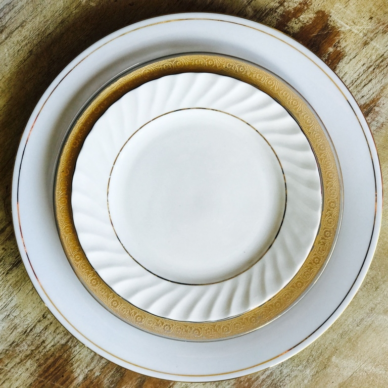 Vintage gold and white china, dinner plate, salad plate, bread plate set for a wedding table. Vintage Rentals in Temecula Valley.