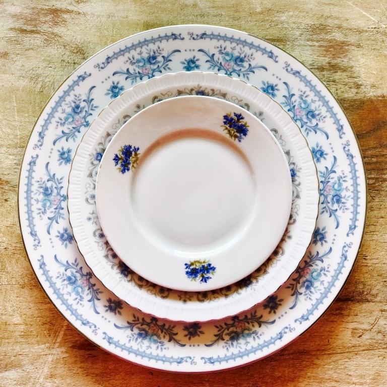 Mismatched vintage china with blue colors. Dinner plates, salad plates, dessert plates, bread plates. Temecula Vintage Event Rentals.