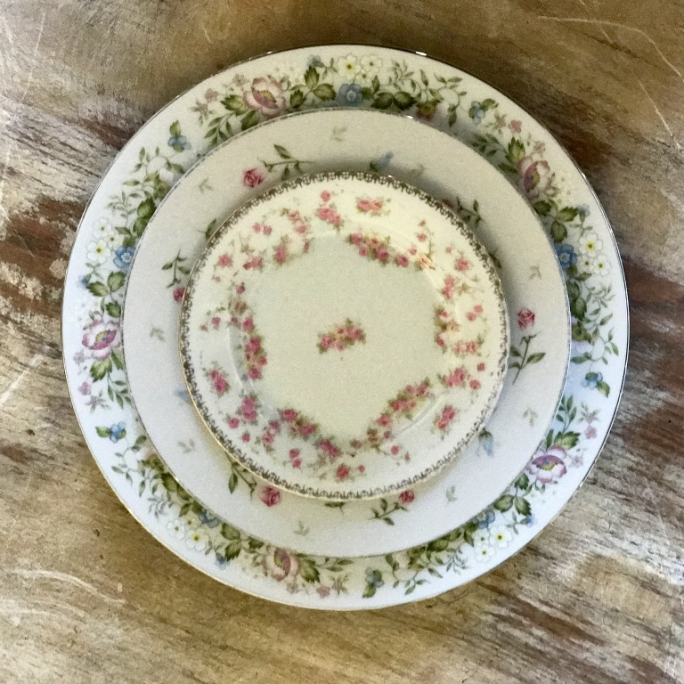Pink floral vintage mismatched shabby chic china. dinner plates full places settings. Wedding Rentals in The Temecula Valley,.