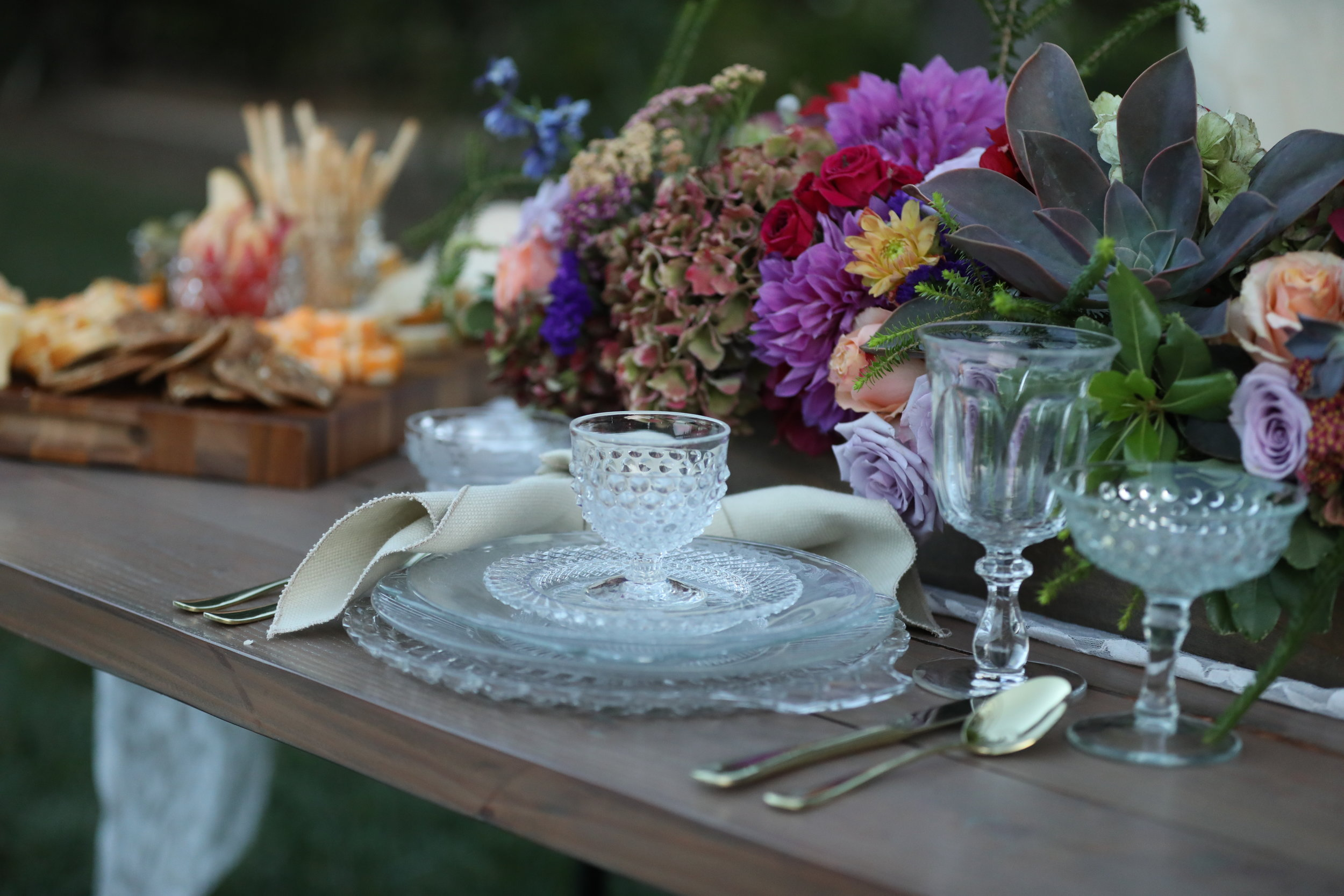 Vintage EAPC cut glass place setting with dinner plates, salad plates, bread plates, and crystal chargers. Perfect to rent for any wedding or event. Temecula Valley Rentals.