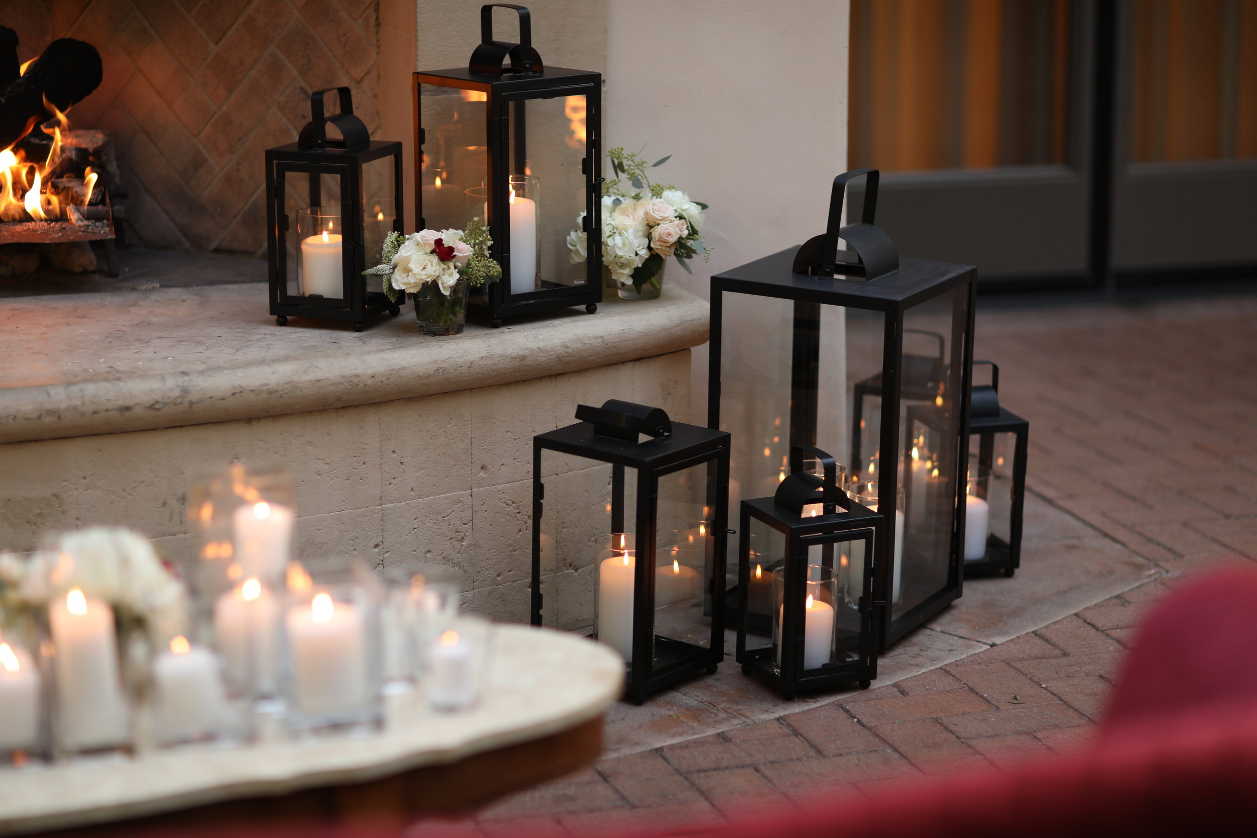 Assorted sizes of black lanterns at Pelican Hill resort wedding.