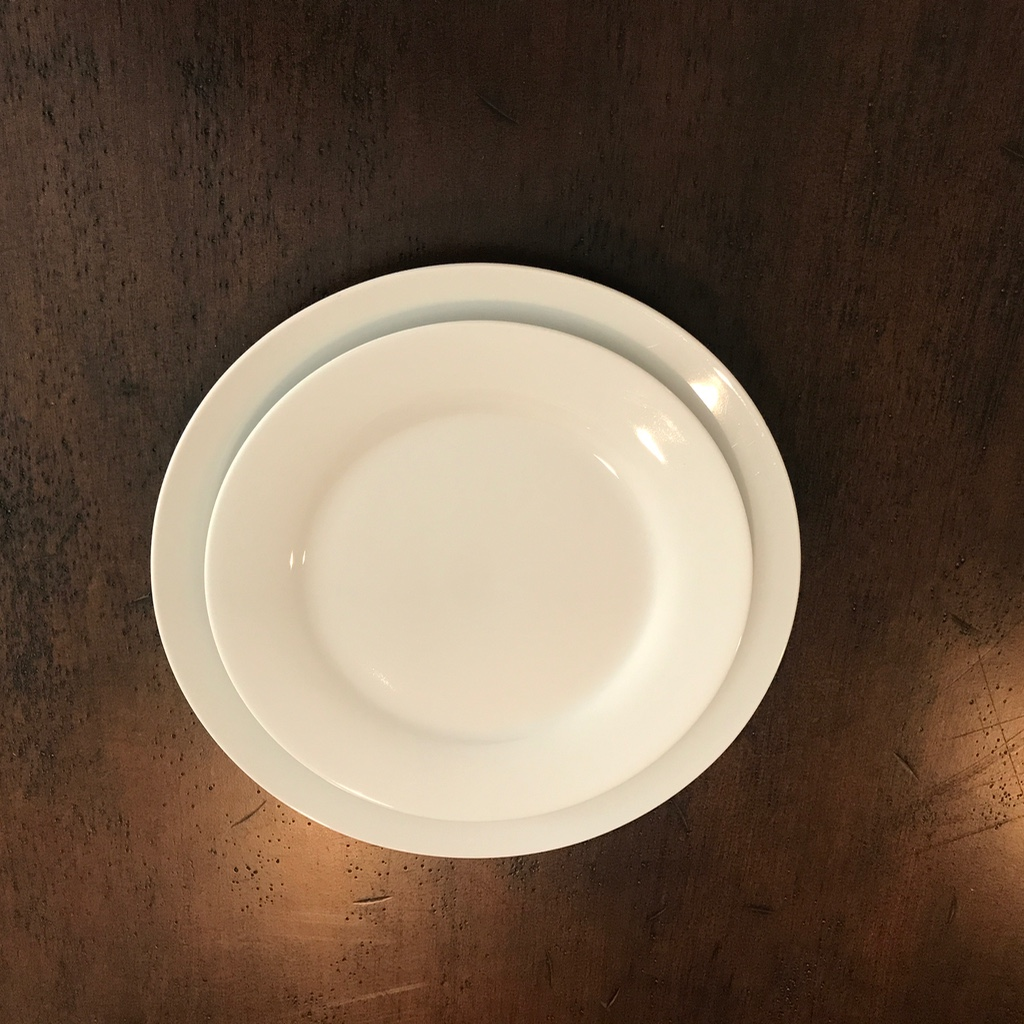 Classic white china dinner and salad plates. Matching. Event and wedding rentals in the Temecula Valley.