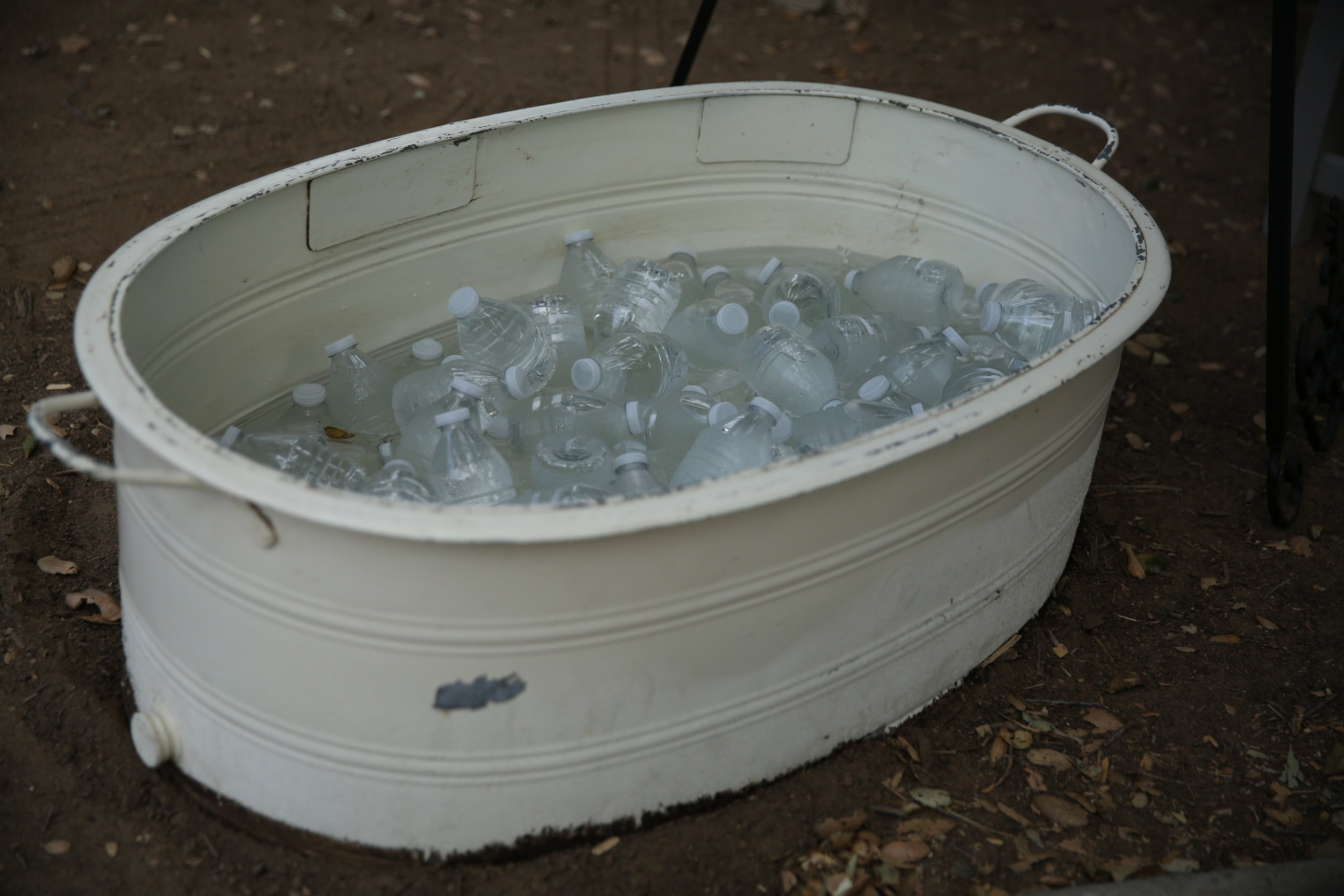 off white galvanized tub filled with water and ice. Beverage dispensers