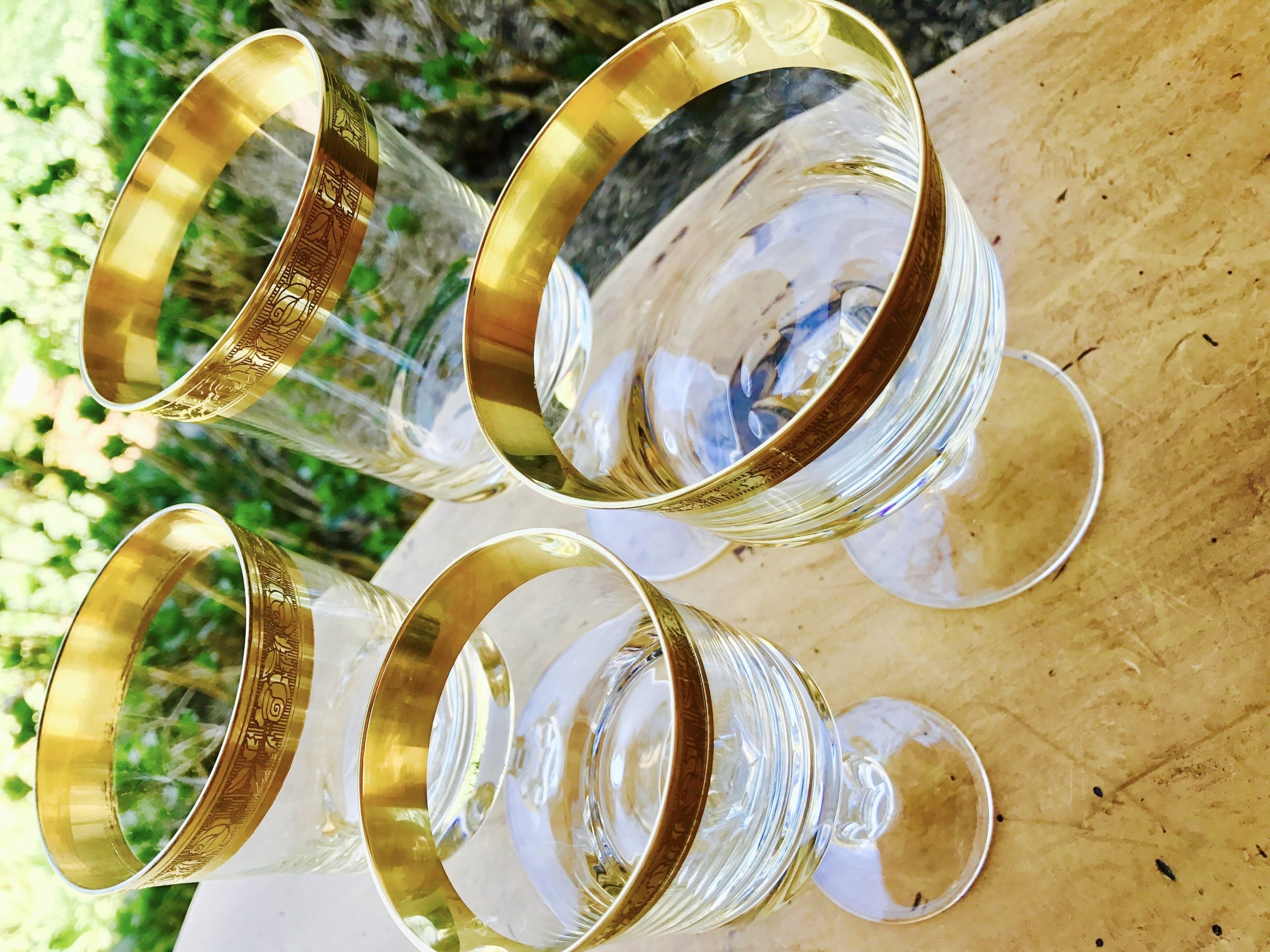 Crystal goblets with wide gold bands.